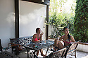 Romania - Timisoara - Nathalie Rose (left) and Lynette Smith (right) having lunch in the courtyard of the Live Cams Mansion. The girls arrive around 12 pm and stay until midnight, they spend most of their days at the Mansion and it gets difficult for them to have a social life outside of it.
