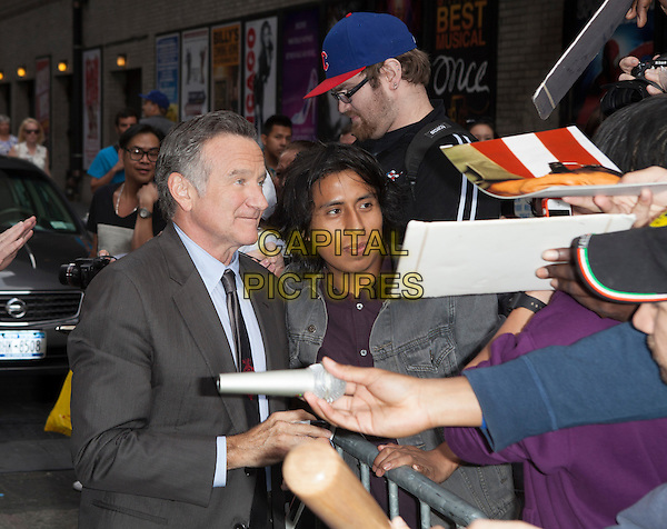 Robin Williams<br /> visits the Late Show With David Letterman, New York City, New York, USA.<br /> September 25th, 2013 <br /> half length grey gray suit profile fans crowd signing autographs <br /> CAP/MPC/COR<br /> &copy;Corredor99/ MediaPunch/Capital Pictures