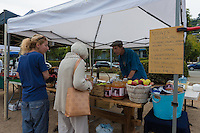 Apples and apple juices in Sausalito farmers market, California, USA