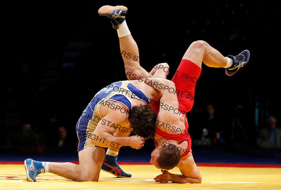 BELGRADE, SERBIA - MARCH 06: Abdusalam Gadisov of Russia (L) competes for the gold medal  with Valerii Andriitsev of Ukraine (R) of Men's Freestyle 96kg during the European wrestling championship March 06, 2011 in Belgrade, Serbia.(Photo by Srdjan Stevanovic/Getty Images)