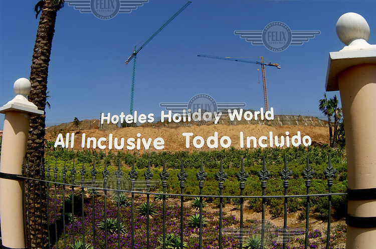 An advertisement at the construction site of a new all-inclusive hotel ('Holiday World').