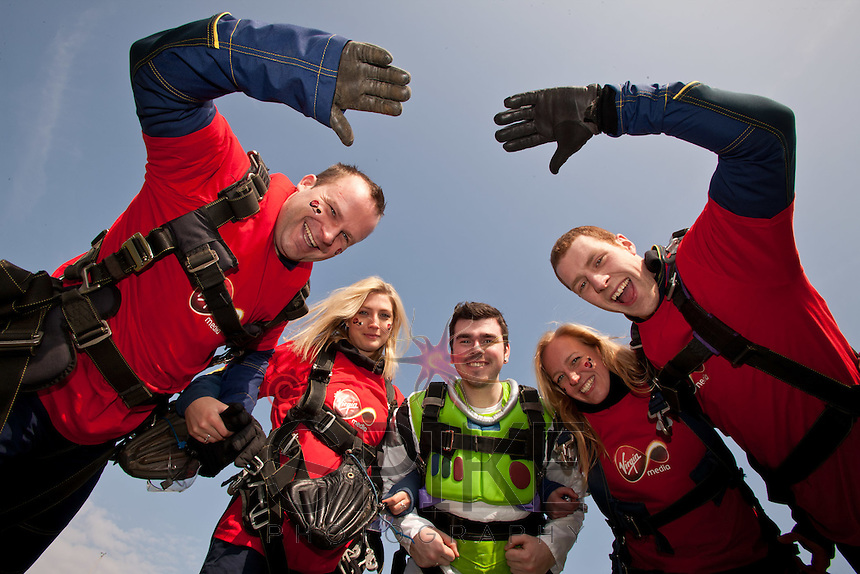 100 staff from Virgin Media descended quite literally on Sibson Airfield at Peterborough for a charity skydive