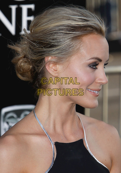Taylor Schilling.The L.A. Premiere of 'The Lucky One' held at The Grauman's Chinese Theatre in Hollywood, California, USA..April 16th, 2012.headshot portrait black sleeveless silver trim halterneck profile hair up bun.CAP/ADM/CH.©Charles Harris/AdMedia/Capital Pictures