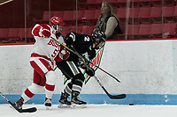 BOSTON, MA - JANUARY 11: Courtney Correia #5 of Boston University and Chloe Gonsalves #12 of Providence College battle in the corner during a game between Providence College and Boston University at Walter Brown Arena on January 11, 2020 in Boston, Massachusetts.
