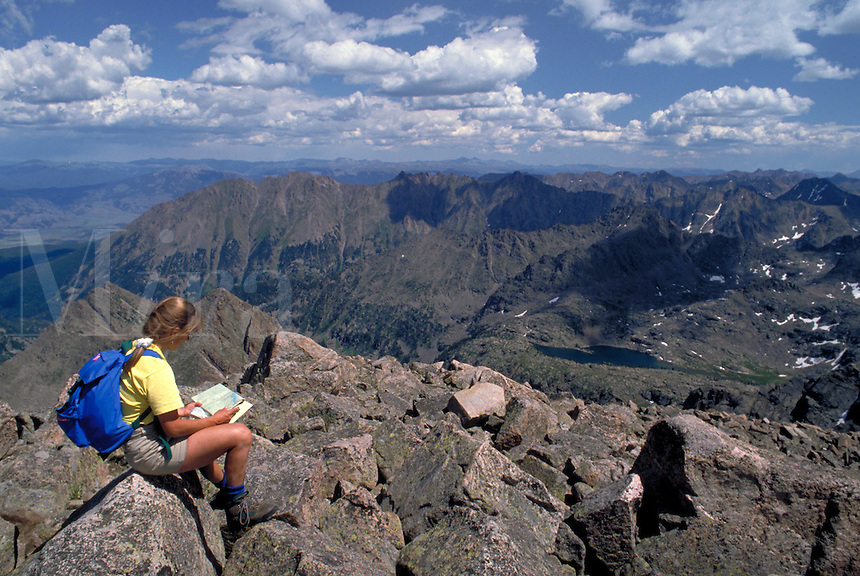 Woman reading map while hiking and backpacking in the scenic backcountry of Eagles Nest Wilderness Area, CO., Colorado.
