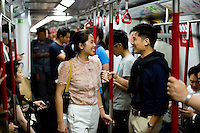HONG KONG - MAY 04: Patricia Szeto and Jonathan Lui take the subway, on May 4, in Hong Kong. (Photo by Lucas Schifres/Pictobank)