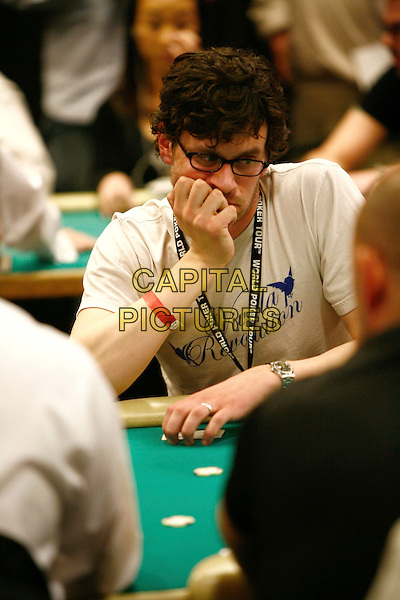 TOM EVERETT SCOTT.World Poker Tour Invitational, Commerce, California, USA..February 22nd, 2006.Photo: Byron Purvis/AdMedia/Capital Pictures.Ref: BP/ADM.half length hand on chin glasses.www.capitalpictures.com.sales@capitalpictures.com.© Capital Pictures.