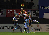 Scott Cuthbert of Luton Town wins the ball in the air during the Sky Bet League 2 match between Luton Town and Wycombe Wanderers at Kenilworth Road, Luton, England on 26 December 2015. Photo by Liam Smith.