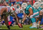 14 September 2014: Miami Dolphins center Samson Satele prepares to snap against the Buffalo Bills at Ralph Wilson Stadium in Orchard Park, NY. The Bills defeated the Dolphins 29-10 to win their home opener and start the season with a 2-0 record. Mandatory Credit: Ed Wolfstein Photo *** RAW (NEF) Image File Available ***