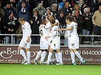 ATTENTION SPORTS PICTURE DESK<br /> Pictured: Craig Beattie of Swansea (C) celebrating his goal with team mates<br /> Re: npower Championship, Swansea City FC v Portsmouth Football Club at the Liberty Stadium, south Wales. Friday 26 November 2010