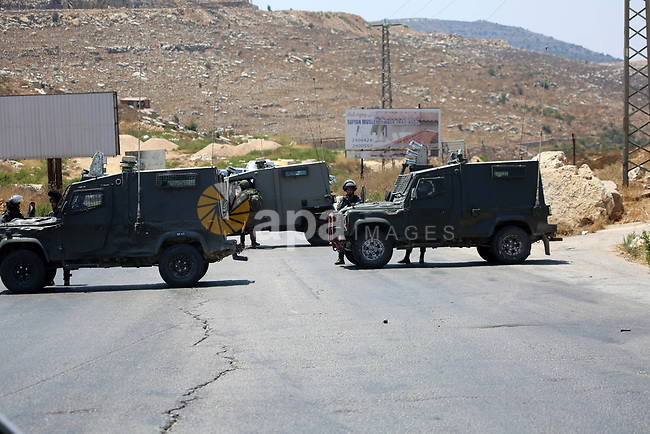Israeli forces close the roads near the area of an attack, west of the West Bank city of Ramallah, Friday, Aug. 23. 2019. An explosion Friday near a West Bank settlement that Israel said was a Palestinian attack killed a 17-year-old Israeli girl and wounded her brother and father, Israeli authorities said. Photo by Hamza Shalash / Wafa / apaimages
