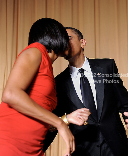 United States President Barack Obamakisses the First Lady during the White House Correspondents' Association Dinner at the Washington Hilton in Washington, DC, on Saturday, May 1, 2010..Credit: Olivier Douliery / Pool via CNP