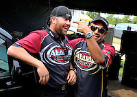 Aug. 18, 2013; Brainerd, MN, USA: NHRA top fuel dragster driver Khalid Albalooshi (right) jokes with teammate Shawn Langdon during the Lucas Oil Nationals at Brainerd International Raceway. Mandatory Credit: Mark J. Rebilas-