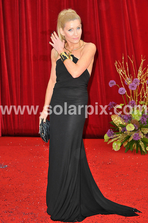 **ALL ROUND PICTURES FROM SOLARPIX.COM**                                             **WORLDWIDE SYNDICATION RIGHTS**                                                                                  Caption: Stars arrive at British TV Soap awards 2011 in Manchester. EastEnders winning Best Soap for the fourth time in a row, but with Corrie sweeping the board and landing eight out of 15 categories. 14 May 2011                                                                             This pic: Michelle Collins                                                                                      JOB REF: 13345 MSR       DATE: 14_05_2011                                                           **MUST CREDIT SOLARPIX.COM OR DOUBLE FEE WILL BE CHARGED**                                                                      **MUST AGREE FEE BEFORE ONLINE USAGE**                               **CALL US ON: +34 952 811 768 or LOW RATE FROM UK 0844 617 7637**