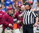 FSU head coach Jimbo Fisher disagrees with a call in the first half of the #2 ranked Florida State Seminoles game against the Florida Gators at Ben Hill Griffin Stadium in Gainesville, Florida November 30, 2013.