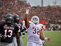 STAFF PHOTO BEN GOFF  @NWABenGoff -- 09/13/14 Arkansas running back Jonathan Williams celebrates after scoring his second touchdown in the first quarter of the game in Jones AT&T Stadium in Lubbock, Texas on Saturday September 13, 2014.