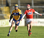 Seadna Morey of Clare in action against Daniel Kearney of Cork during their Munster Hurling League game at Cusack Park. Photograph by John Kelly.