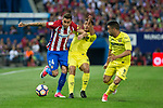 Jose Maria Gimenez of Atletico de Madrid holds off pressure from  Jonathan Dos Santos and Jaume Costa of Villarreal during the match of La Liga between Atletico de Madrid and Villarreal at Vicente Calderon  Stadium  in Madrid, Spain. April 25, 2017. (ALTERPHOTOS/Rodrigo Jimenez)