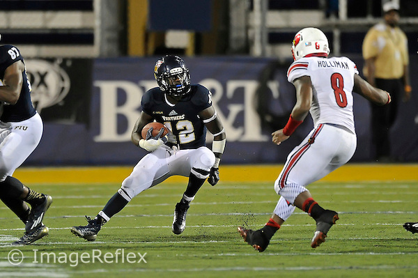 20 September 2014:  FIU running back Anthon Samuel (42) carries the ball in the second half as the University of Louisville Cardinals defeated the FIU Golden Panthers, 34-3, at FIU Stadium in Miami, Florida.