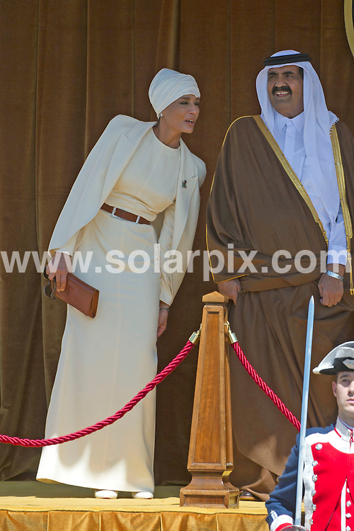 **ALL ROUND PICTURES FROM SOLARPIX.COM**                                             **WORLDWIDE SYNDICATION RIGHTS EXCEPT SPAIN - NO SYNDICATION IN SPAIN**                                                                                  Caption: The Spanish royal family - King Juan Carlos, Queen Sofia, Prince Felipe, Princess Letizia and Princess Cristina - have lunch with the Emir of Qatar Sheikh Hamad bin Khalifa Al Thani, and one of his 4 wives - Jaquesa Mozah Bint Nassar. Zarzuela Palace, Madrid, Spain. 25 April 2011.                                                                              This pic:  Emir of Qatar, Jaquesa Mozah Bint Nassar                                                                                            JOB REF: 13192 DMS       DATE: 25_04_2011                                                            **MUST CREDIT SOLARPIX.COM OR DOUBLE FEE WILL BE CHARGED**                                                                      **MUST AGREE FEE BEFORE ONLINE USAGE**                               **CALL US ON: +34 952 811 768 or LOW RATE FROM UK 0844 617 7637**