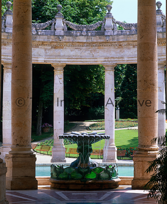 A garlanded circular colonnade surrounds a fountain at the Tettuccio spa