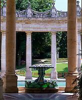 A garlanded circular colonnade surrounds a fountain at the Tettuccio spa