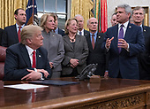 United States President Donald J. Trump listens as US Representative Michael McCaul (Republican of Texas) makes remarks prior to his signing the bipartisan Interdict Act, a bill to stop the flow of opioids into the United States in the Oval Office of the White House in Washington, DC on Wednesday, January 10, 2018.  The Interdict Act will provide Customs and Border Protection agents with the latest screening technology devices used to secure our border from illicit materials, specifically fentanyl, a powerful opioid that is destroying lives across the country. <br /> Credit: Ron Sachs / Pool via CNP