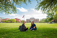 Danielle McLendon, a junior civil engineering major from Purvis, and Jennifer Sappington, a senior biochemistry major from Hattiesburg, find a shaded spot to enjoy a nice spring day on the MSU Drill Field. <br />