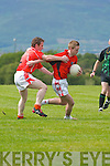 Jack Cahill, Brosna, tries to block Glenbeigh/Glencars lively Steve Caulfield in their County League.Division Four clash at Glenbeigh last Saturday.