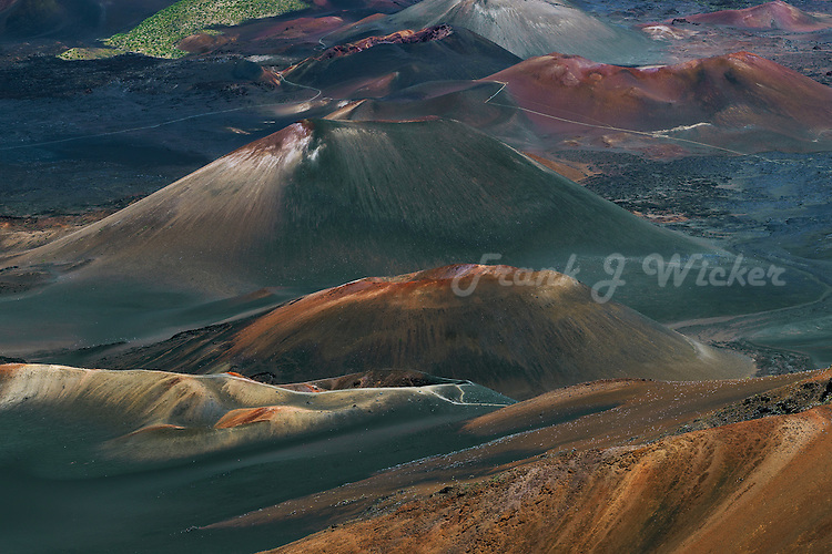 Multiple multi colored cinder cones in the crater of HALEAKALA NATIONAL PARK on Maui in Hawaii