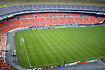 30 October 2004: The east bowl at RFK Stadium. The lower section (red seats) roll around to the north side of the bowl to form the third base line when the stadium is configured for baseball. The third base dugout can be seen on the left covered with boards. The seats currently in the north end are removed altogether. DC United defeated the MetroStars 2-0 at RFK Stadium in Washington, DC in the second leg of their Major League Soccer Eastern Conference Semifinal playoff series. United eliminated the MetroStars 4-0 on aggregate goals..