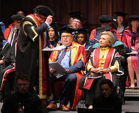 Pictured: Hillary Clinton (R) while being awarded an honorary degree at Swansea University Bay Campus. Saturday 14 October 2017<br /> Re: Hillary Clinton, the former US secretary of state and 2016 American presidential candidate will be presented with an honorary doctorate during a ceremony at Swansea University's Bay Campus in Wales, UK, to recognise her commitment to promoting the rights of families and children around the world.<br /> Mrs Clinton's great grandparents were from south Wales.