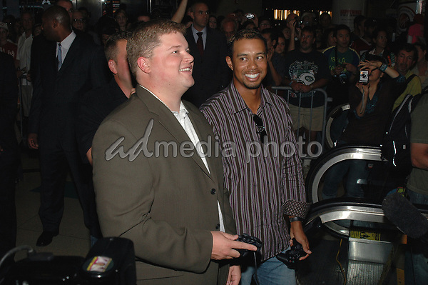 "26 September 2005 - New York, New York - Tiger Woods shows takes on a challenger on his 'hole in one' during an appearance at the Virgin Megastore in Times Square to promote his new Electronics Arts game, ""Tiger Woods:PGA Tour 2006"".  Photo Credit: Patti Ouderkirk/AdMedia"