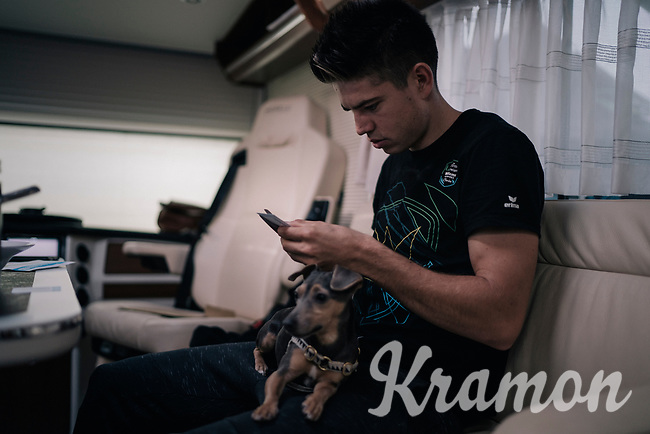 CX World Champion Wout Van Aert (BEL/Crélan-Charles) preparing for the race in his camper; cutting racenumbers to size<br /> <br /> Super Prestige Ruddervoorde / Belgium 2017