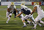 UC Davis' Desmond Lewis (34) runs against Nevada defenders Patrick Choudja (95) and Alex Bertrando (56) during the second half of an NCAA college football game in Reno, Nev. on Thursday, Sept. 3, 2015. UC Davis' Andrew Hunter (76) was in on the play. Nevada won 31-17. (AP/Cathleen Allison)