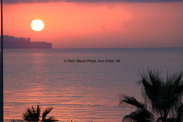 A view of the morning sun in a pink sky over the Mediterranean in Antalya, Turkey in early November.