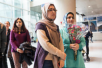 Motahhare Eslami (right), of Urbana-Champaign, Illinois, and Sahar Harati, of Atlant, Georgia, wait for the arrival of each's parents at Logan Airport's Terminal E in Boston, Massachusetts, USA. The two were university classmates in Iran, and now both live in the US. Both of their mothers and fathers were on a Lufthansa flight from Frankfurt, Germany, one of the first flights allowing people from seven Muslim-majority countries banned from traveling to the US under an executive order signed by President Donald Trump. Eslami's parents had planned to travel a week earlier but were prevented from traveling due to the executive order. She has a single-entry visa so could not risk a trip outside of the United States. Harati's parents had a trip planned for March 1, but decided to move it up to January 28 because of Trump's stance on travelers from Iran. They were turned away from their planned flight from Doha to Atlanta, but when the flight from Frankfurt to Boston opened up, they got tickets and flew to the US.