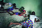 KINSHASA, DEMOCRATIC REPUBLIC OF CONGO - JULY 4: Esther Yandakwa (c), age 9, plays in her bed with her friends at a yearly summer camp run by Orper, a local NGO on July 4, 2006 in N Djili outside Kinshasa, Congo, DRC. The NGO has several shelters for homeless boys and girls in Kinshasa and has a program that reunites children with their families. Esther is homeless since a few years and has run away from her family. She smokes, drinks, and abuse drugs such as Valium. She often works as a prostitute on the streets of Kinshasa to make money. The capital has a growing problem with children displaced by war, poverty and many has been rejected by their families and forced on the streets. About 15,000 children are estimated to live on the streets of Kinshasa. About fifty girls got to spend a week relaxing, playing, swimming eating three meals a day. Most important of all, it took them off the hard streets of Kinshasa, where they are often abused, take drugs and forced into prostitution. Esther has lived on the streets for a few years and run away from her family. She abuse drugs, alcohol and works as prostitute. Congo, DRC is in ruins after forty years of mismanagement by the corrupt dictator and former president Mobuto Sese Seko. He fled the country in 1997 and a civil war started. The country is planning to hold general elections by July 2006, the first democratic elections in forty years. (Photo by Per-Anders Pettersson)