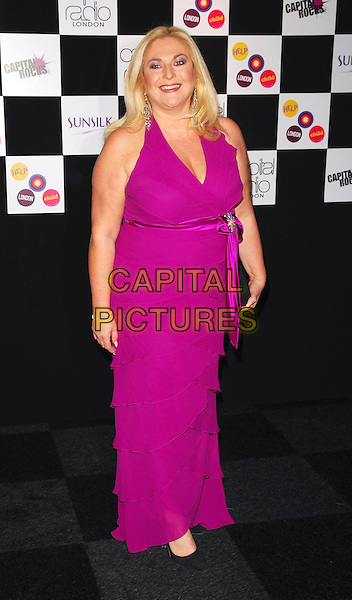 VANESSA FELTZ .At the Capital Rocks! Party, .Battersea Park Events Arena, London, .England, December 12th 2006..full length pink purple dress .CAP/CAN.©Can Nguyen/Capital Pictures