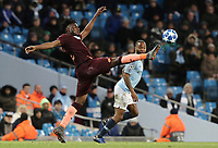1899 Hoffenheim's Kasim Adams stretches for a high ball under pressure from Manchester City's Raheem Sterling<br /> <br /> Photographer Rich Linley/CameraSport<br /> <br /> UEFA Champions League Group F - Manchester City v TSG 1899 Hoffenheim - Wednesday 12th December 2018 - The Etihad - Manchester<br />  <br /> World Copyright © 2018 CameraSport. All rights reserved. 43 Linden Ave. Countesthorpe. Leicester. England. LE8 5PG - Tel: +44 (0) 116 277 4147 - admin@camerasport.com - www.camerasport.com