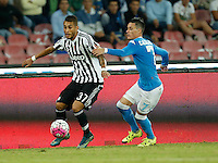Juventus' Roberto Pereyra is challenged by Napoli's Jose Callejon  during the  italian serie a soccer match,    at  the San  Paolo   stadium in Naples  Italy , September 26 , 2015