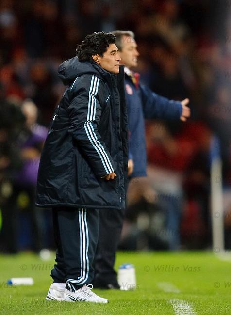 Diego Maradona watches on with George Burley
