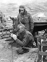 "Maj. Gen. Frank Lowe, USA, presidential representative in Korea, examines ""flash range"" instruments on the Marine front lines.  Explaining the instrument is Marine S.Sgt. Charles Kitching of Redlands, Calif.  March 1951.  T. Sgt. Vance Jobe.  (Marine Corps)<br /> Exact Date Shot Unknown<br /> NARA FILE #:  127-N-A131033<br /> WAR & CONFLICT BOOK #:  1409"