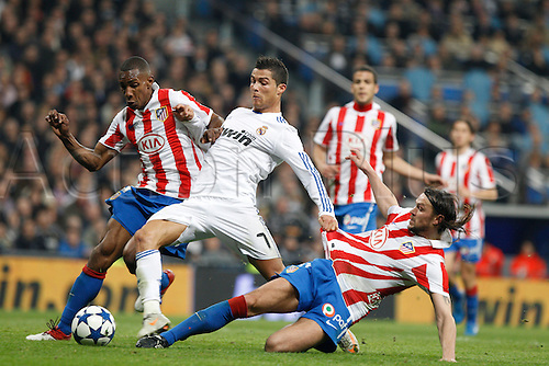 13.01.2011 Spanish Copa del Rey from the Santiago Bernebeu. Real Madrid vs At. Madrid 3-1. Picture shows  (L) Perea and Ujfalusi (R) defending against Ronraldo....