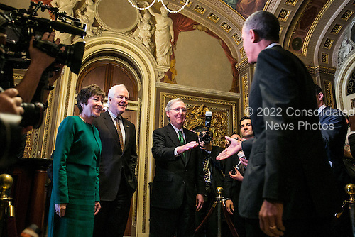 United States President Barack Obama is greeted by U.S. Senators Susan Collins (Republican of Maine), John Cornyn (Republican of Texas) and U.S. Senate Republican Leader Mitch McConnell (Republican of Kentucky) as he arrives at the U.S. Capitol to meet with Senate Republicans, on Capitol Hill in Washington, Thursday, March 14, 2013. Later in the day, President Obama will also meet with the House Democratic Caucus. .Credit: Drew Angerer / Pool via CNP