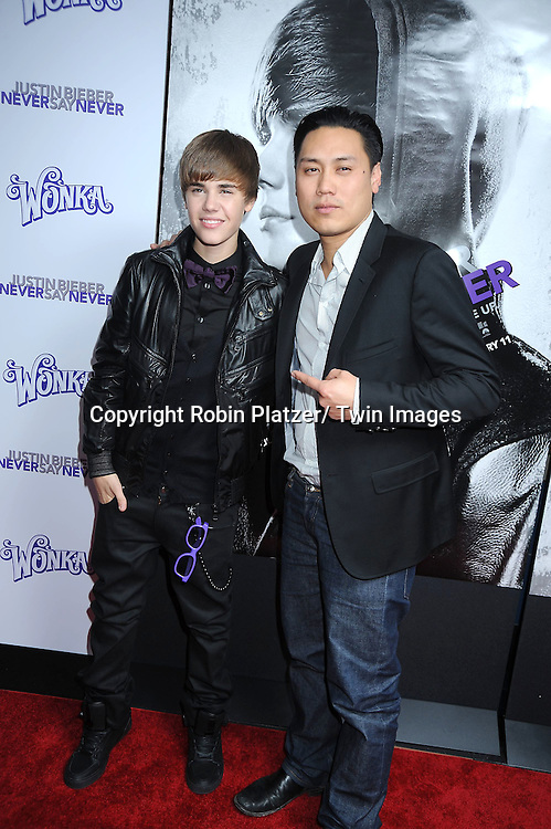 "Justin Bieber and director John Chu attending The New York Special Screening of ""Justin Bieber: Never Say Never"" on February 2, 2011 at The Regal E-Walk Stadium Theatre in New York City."