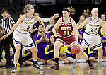 SIOUX FALLS, SD: MARCH 4: Jesse Spittel #31 of Denver drives between Western Illinois defenders Olivia Braun #3 and Michelle Farrow #22 on March 4, 2017 during the Summit League Basketball Championship at the Denny Sanford Premier Center in Sioux Falls, SD. (Photo by Dick Carlson/Inertia)