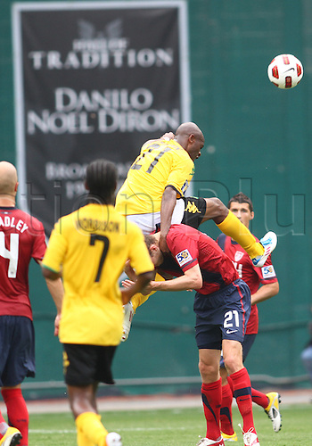 19.06.2011. Washington, USA.  Clarence Goodson (21) of  USA is hit by Luton Shelton (21) of Jamaica during a CONCACAF Gold Cup quarter-final match at RFK stadium in Washington D.C. USA won 2-0.