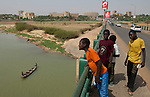 Niamey - Niger, March 30, 2012 -- Bridge over and banks of River 'Fleuve' Niger at low water-level; people, infrastructre -- Photo © HorstWagner.eu