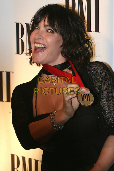 DANIELLE BRISEBOIS.55th Annual BMI Pop Music Awards held at the Regent Beverly Wilshire Hotel, Beverly Hills, California, USA..May 15th, 2007.half length black medal necklace dress mouth open .CAP/ADM/CH.©Charles Harris/AdMedia/Capital Pictures